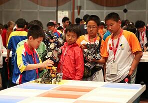 Elementary students at the World Robot Olympaid on November 10, 2012. CHEN WS / Shutterstock.com